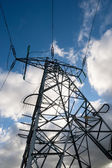 Power lines dark skies — Stock Photo