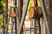 Chain hoist with a large wooden pole. — Stock Photo