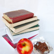 Apple, chocolate, books — Stock Photo