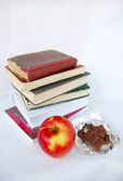 Apple, chocolate, books — Stock Photo