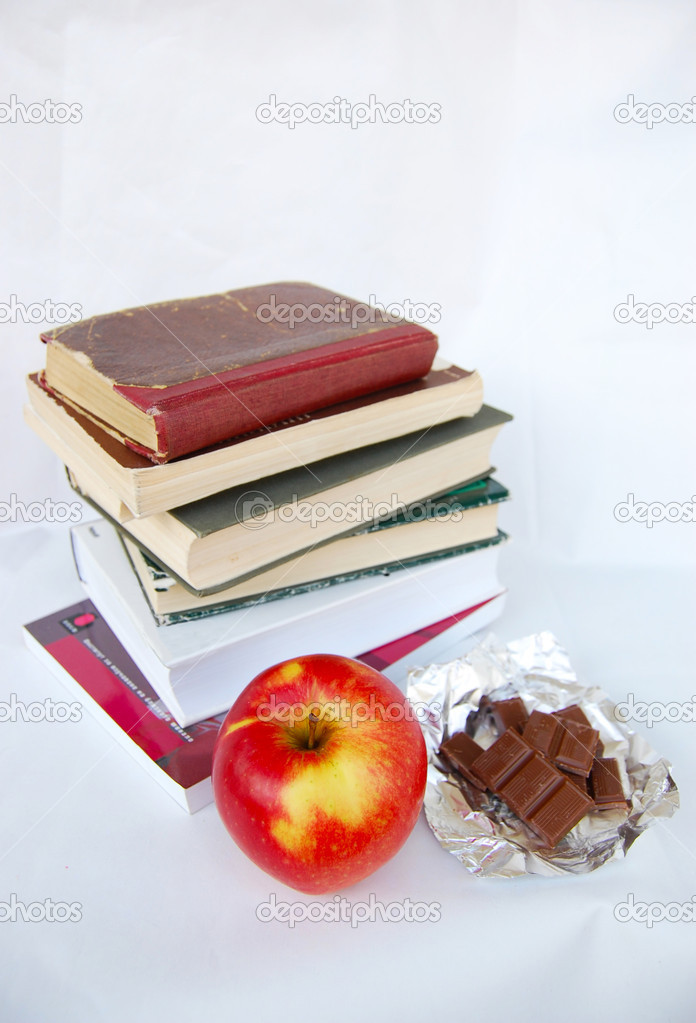 Apple, chocolate bars and books — Stock Photo #19401445
