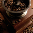 Retro Coffee Mill with beans — Stock Photo