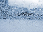 Ice pattern on window glass — Stock Photo