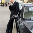 Young handsome man, model of fashion, with luxury cars — Stock Photo #19284827