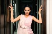 Portrait of a young black woman, model of fashion, with pink dress — Stock Photo