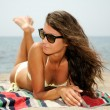 Portrait of a woman with beautiful body on a tropical beach — Stock Photo