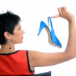 Beautiful woman with blue shoe — Stock Photo
