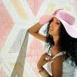 Young black woman wearing dress and sun hat, afro hairstyle — Stock Photo