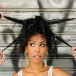 Young black woman, afro hairstyle, in urban background — Stock Photo
