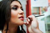 Professional makeup with a beautiful young woman — Stock Photo
