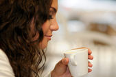Beautiful elegant woman with coffee cup — Stock Photo