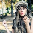 Portrait of beautiful girl with the winter hat on  — Stock Photo