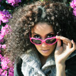 Funny black girl with purple heart glasses — Stock Photo
