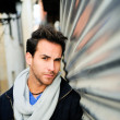 Portrait of handsome happy man in urban background  — Stok fotoğraf