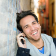 Stock Photo: Portrait of handsome man in urban background talking on phone