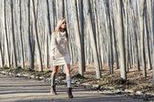 Beautiful blonde girl, dressed with beige dress, walking in a ru — Stock Photo