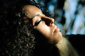 Black beautiful woman with closed eyes — Stock Photo