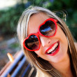 Funny girl with red heart glasses — Stock Photo