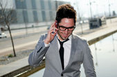 Portrait of a handsome young business man talking on mobile phon — Stock Photo