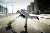 Funny man dressed in suit with a suitcase — Stock Photo