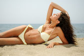Woman with beautiful body on a tropical beach — Stock Photo