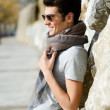 Attractive young handsome man, model of fashion in the park — Stock Photo