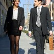 Attractive business walking on the street. Couple working — Stock Photo