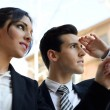 Attractive business looking at something interesting. Cou — Stock Photo