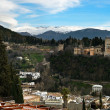 Alhambra and snowing Sierra Nevada mountains under a lenticular - Stock Photo
