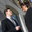 Stock Photo: Business talking outside of company building. Couple work