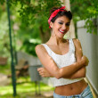Pin-up girl. American style, in a garden — Stock Photo #21759911