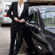 Young handsome man, model of fashion, with luxury cars — Stock Photo