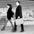 Business walking in the street. Couple working — Stock Photo