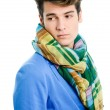Attractive young man wearing blue jacket and scarf — Stock Photo #24133647