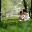 Mother and little girl playing in the park — Стоковая фотография