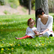 Mother and little girl playing in the park — Stock Photo