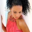 Stock Photo: Black woman with pink dress and earrings. Afro hairstyle