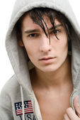 Handsome young man in a hood — Stock Photo