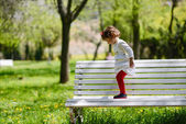 Little girl playing in the park — Stock Photo