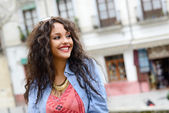 Attractive mixed woman in urban background wearing casual clothe — Stock Photo