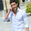 Royalty-Free Stock Photo: Handsome man in urban background talking on phone
