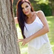 Beautiful girl with green eyes in the park  — Stockfoto