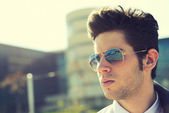 Attractive young man with sunglasses — Stock Photo