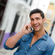 Handsome man in urban background talking on phone — Stock Photo #27130885