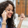 Beautiful mixed woman in urban background on the phone — Stock Photo