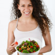 Beautiful young mixed woman with salad, isolated on white — Stock Photo