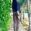 Beautiful woman, model of fashion, wearing leopard pants — Stock Photo