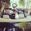 Stock Photo: Just married couple in old car