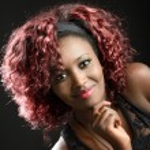Beautiful black woman on black background. Studio shot — Stock Photo #32804473