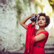 Stock Photo: Beautiful woman in urban background. Vintage style